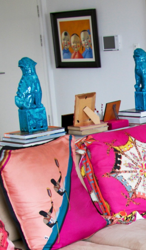 Vintage Gucci and Pucci scarves made into throw pillows.  Precious Chinese baby face art in the background.